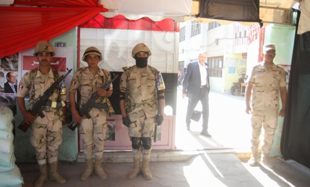 In pics: Security measures beefed up as Egyptians at home vote in referendum