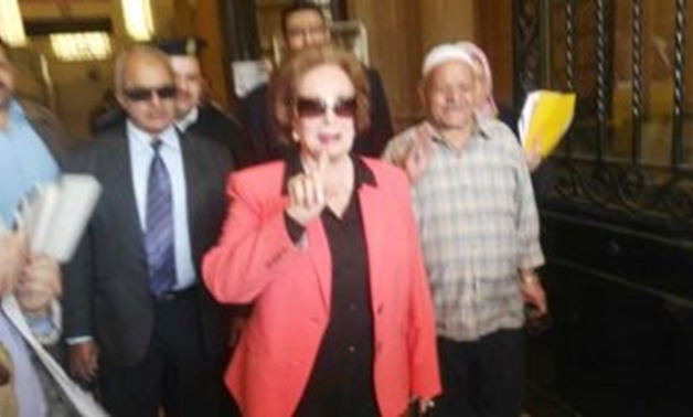 The widow of Anwar Sadat, Jihan Sadat, cast on Saturday her ballot in the referendum on the constitutional amendments in Dokki, Giza - Press Photo