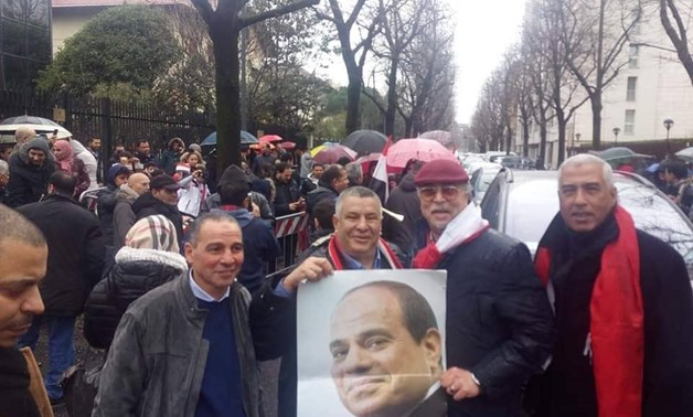 Egyptian nationals in Milan, Italy, headed to the Egyptian Embassy to cast their ballots for the second day on the new amendments to the Egyptian Constitution - Egypt Today/ Hossam El-Din Mohamed