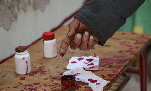 Man inked his finger after casting vote in 2019 referendum in constitutional amendment in Shubra district, Cairo - Karim Abdel Aziz/Egypt Today