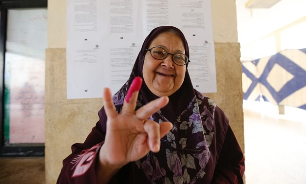 Woman voter shows her inked finger after casting her vote in referendum in 6 of October city - Mohamed el-Hosary/Egypt Today
