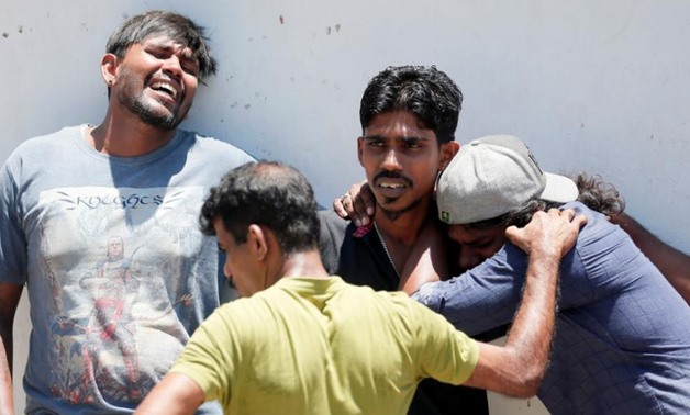 Relatives of a victim of the explosion at St. Anthony's Shrine, Kochchikade church react at the police mortuary in Colombo, Sri Lanka April 21, 2019. REUTERS/Dinuka Liyanawatte