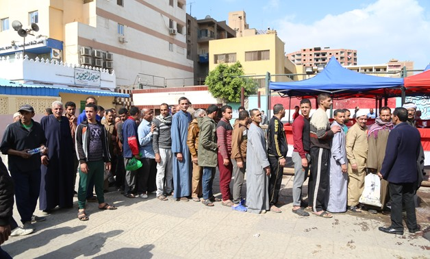 FILE - Queues of voters lined up outside polling stations in Giza to vote in referendum - Photo by Karim Abdel Aziz/Egypt Today