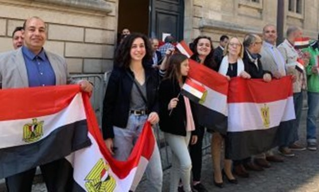 FILE - Egyptian expats standing in front of one of Egypt's embassies after voting in the referendum on constitutional amendments