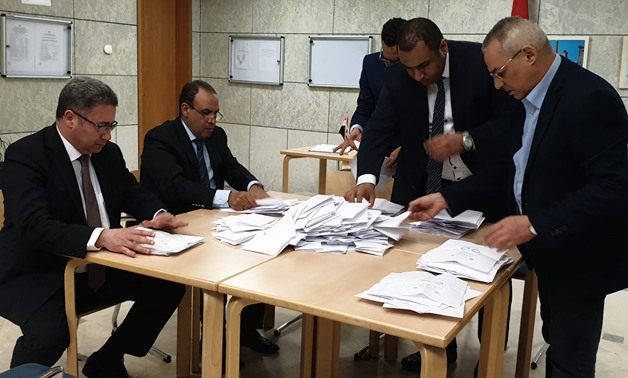 Egyptian ambassador to Germany Badr Abdel-Atti and other members of the diplomatic missions sort the expats' ballots on the constitutional amendments at the embassy in Berlin on Monday, April 22,2019- Press photo