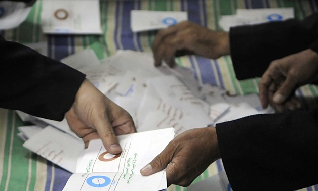 FILE - Officials count ballots after polls closed in Zagazig northeast of Cairo on Dec.15, 2012- Reuters