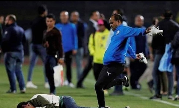 Zamalek's staff member attacks one of the photographers after the match - FILE
