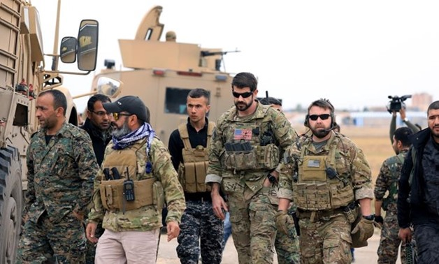 Washington said earlier this month it would leave about 400 US troops split between two different regions of Syria [File: Rodi Said/Reuters]