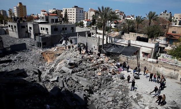 Palestinians inspect a destroyed Hamas site after it was targeted by an Israeli air strike in Gaza City March 26, 2019. REUTERS/Mohammed Salem
