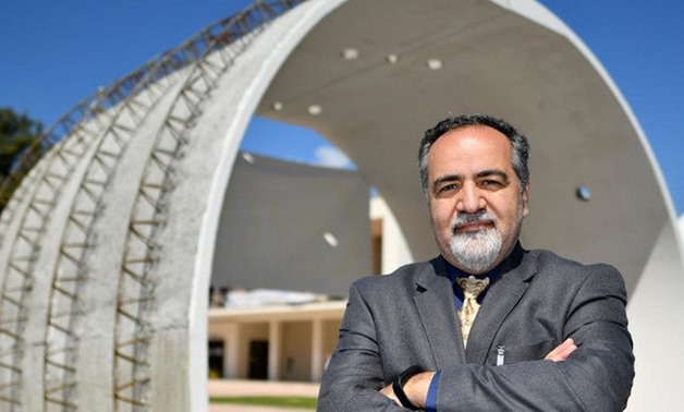 American professor in mining engineering, Jamal Rostami, poses by a concrete tunnel structure within the World Tunnel Congress WTC 2019 on May 7, 2019 in Naples. (AFP / Alberto Pizzoli)