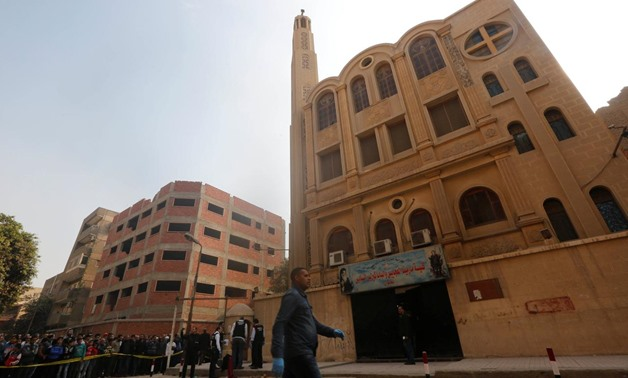 FILE PHOTO: Policemen inspect the site of attack on Mar Mina church in Helwan district on the outskirts of Cairo, Egypt, December 29, 2017 - REUTERS.
