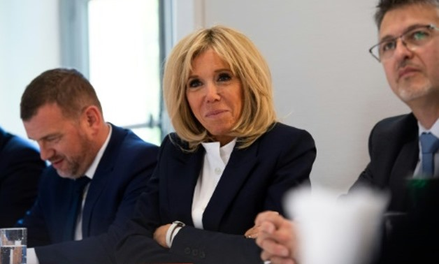 Brigitte Macron wants to pick up her career as a teacher at two new centres directed at adults who dropped out of school AFP