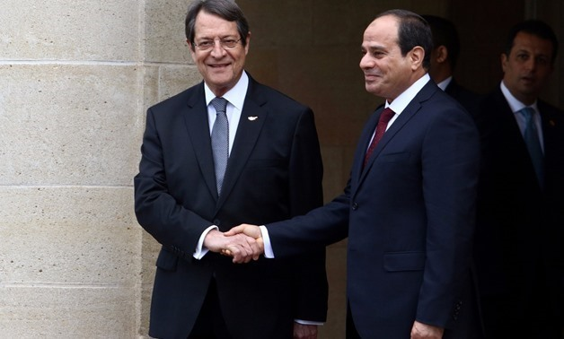 Cypriot President Nicos Anastasiades (L) and Egyptian President Abdel Fattah al-Sisi shake hands at the Presidential Palace in Nicosia, Cyprus November 20, 2017 - REUTERS/Yiannis Kourtoglou