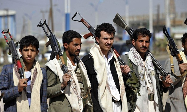 Armed members of Houthis gather at Sebin Square as they close the Sebin Road to traffic near presidential palace following the conflicts in Sana'a, Yemen. Photograph: Getty