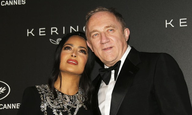 72nd Cannes Film Festival - The Kering Women In Motion Honor Awards as part of Cannes Film Festival Presidential dinner - Arrivals - Cannes, France, May 19, 2019. Salma Hayek and Francois-Henri Pinault pose. REUTERS/Regis Duvignau