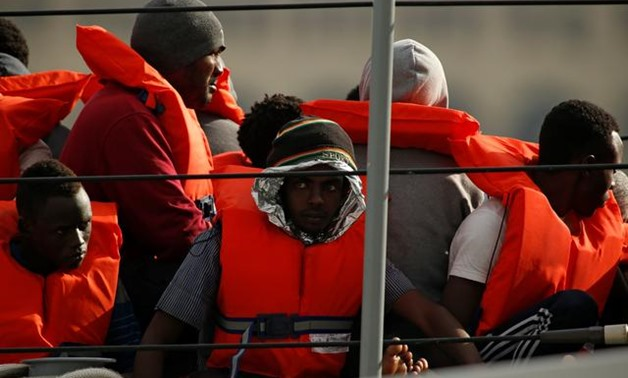 A Maltese armed forces patrol boat picked up more than 200 migrants from two dinghies in the Mediterranean and was bringing them to Malta on Saturday, a spokesman said.
