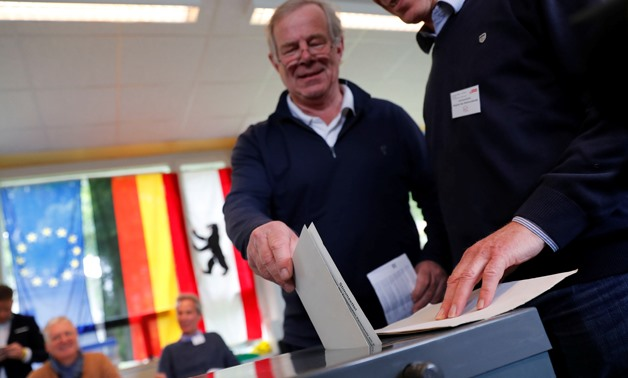 A man casts his vote for the European Parliament elections at a polling station in Berlin, Germany, May 26, 2019. REUTERS/Fabrizio Bensch