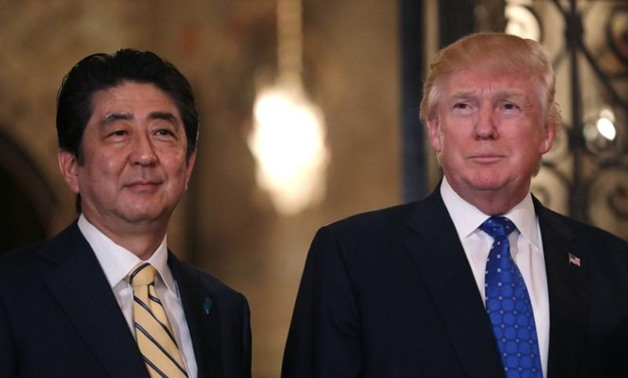 FILE PHOTO: Japanese Prime Minister Shinzo Abe and U.S. President Donald Trump pose for a photograph before attending dinner at Mar-a-Lago Club in Palm