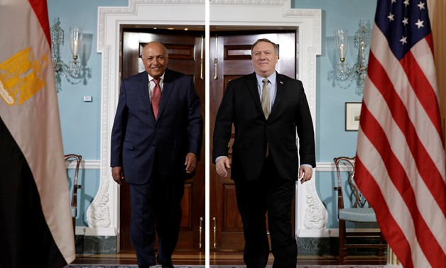 FILE - U.S. Secretary of State Mike Pompeo shakes hands with Egyptian Foreign Minister Sameh Shoukry before their meeting at the State Department in Washington, U.S., August 8, 2018. REUTERS/Yuri Gripas