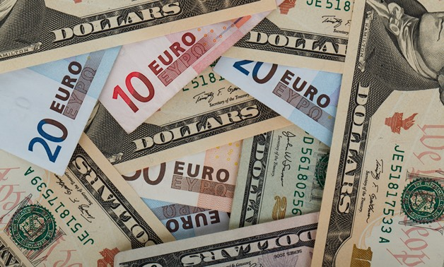 FILE – Dollars and Euros – public domain pictures/Petr Kratochvil
