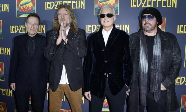 FILE PHOTO - Members of British rock band Led Zeppelin (L-R) bass player John Paul Jones, lead singer Robert Plant, guitarist Jimmy Page and drummer Jason Bonham, who replaces the band's original drummer his father John Bonham, arrive for the premiere of