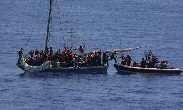 A smallboat crew from the Coast Guard Cutter Tahoma bring aboard Haitian migrants interdicted at sea from a sail freighter south of Acklins Island, Bahamas in this file photo from 2010. Coast Guard crews rescue undocumented migrants who put their lives in