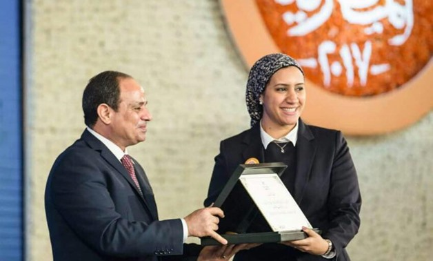 Aya Medany is honored by President Abdel Fatah al-Sisi- photo courtesy of Aya Medany آية مدني Facebook page