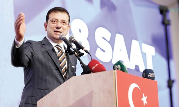 The opposition candidate, Ekrem Imamoglu, addresses a meeting in Istanbul on Friday ahead of June 23 re-run of Istanbul elections. (AP)
