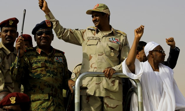 Lieutenant General Mohamed HamdanDagalo, deputy head of the military council and head of paramilitary Rapid Support Forces (RSF), greets his supporters as he arrives at a meeting in Aprag village, 60 kilometers away from Khartoum, Sudan, June 22, 2019. RE