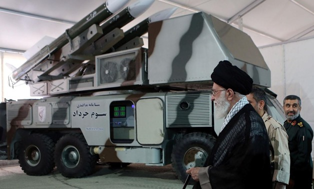 "Iran's Supreme Leader Ayatollah Ali Khamenei is seen near a ""3 Khordad"" system which is said to had been used to shoot down a U.S. military drone, according to news agency Fars, in this undated handout picture. Fars news/Handout via REUTERS"