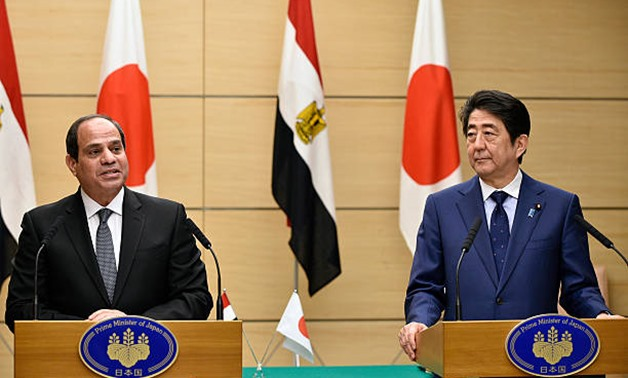 Egypt's President Abdel Fattah El-Sisi (R) attends with Japan's Prime Minister Shinzo Abe (L) agreements signings at Abe's official residence in Tokyo, Japan - Photo courtesy of the Egyptian Presidency