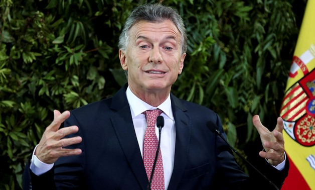 FILE PHOTO: Argentina's President Mauricio Macri gestures as he gives a speech during a state dinner at the Centro Cultural Kirchner, in Buenos Aires