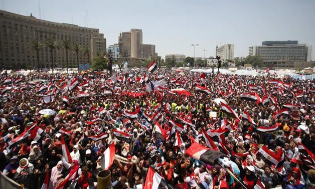 FILE- Egyptians protest against the regime of the Muslim Brotherhood in 2013- Reuters