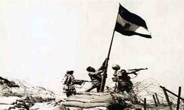 Late Soldier Mohamed Mohamed Abdel Salam al-Abassy raises the Egyptian flag on Bar Lev Line that used to lie on the eastern shore of the Suez Canal before it was destroyed by the Egyptian Army in October 1973. Wikimedia Commons