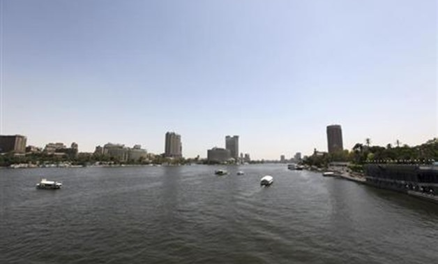 Boats travel in the Egyptian Nile River in Cairo May 28, 2013. REUTERS/Mohamed Abd El Ghany