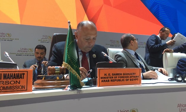 FILE-  Foreign Minister Sameh Shoukry gives a speech at African Union's executive council currently held in Niamey- Press photo
