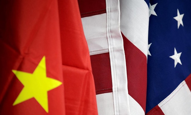 FILE PHOTO: Flags of U.S. and China are displayed at American International Chamber of Commerce (AICC)'s booth during China International Fair for Trade in Services in Beijing, China, May 28, 2019. REUTERS/Jason Lee/File Photo