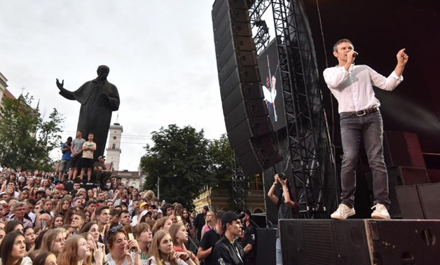 "Sviatoslav Vakarchuk, Ukrainian musician and frontman of a popular rock band Okean Elzy and head of political party ""Voice"", attends a pre-election rally and a concert in Lviv, Ukraine June 18, 2019. REUTERS/Pavlo Palamarchuk"