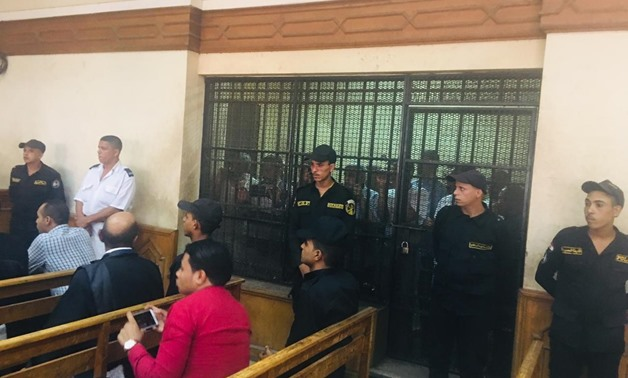 """The 14 defendants charged with negligence in the lawsuit dubbed """"Ramses Station Blaze"""" appear before Cairo Criminal Court's judiciary panel in the first trial session. July 9, 2019. Egypt Today"""