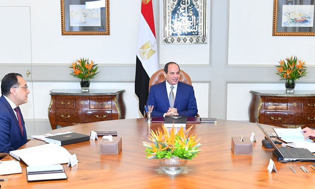 File - Sisi meets with Prime Minister Moustafa Madbouli and the higher education minister - press photo