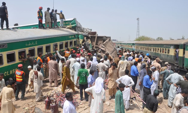 Residents and rescue workers gather near the site after a passenger train collided with a cargo train in Sadiqabad, Pakistan July 11, 2019. REUTERS/Stringer NO RESALES. NO ARCHIVES.