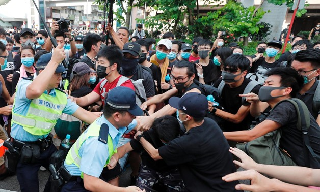 Police try to disperse pro-democracy activists after a march at Sheung Shui, a city border town in Hong Kong, China July 13, 2019. REUTERS/Tyrone Siu