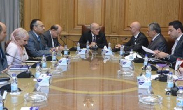 Minister of Military Production Mohamed al-Assar (middle) and the managing director of Trayal Corporation and accompanying delegation (r) in a meeting in Cairo, Egypt. July 15, 2019. Press Photo