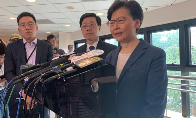 Hong Kong Chief Executive Carrie Lam (R) and Secretary for Security John Lee Ka-chiu speak to media over an extradition bill protest in Hong Kong, China July 15, 2019. REUTERS/Joyce Zhou