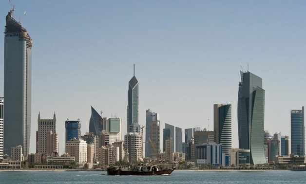FILE PHOTO: A fishing boat passes in front of the Kuwait City skyline September 11, 2010. REUTERS/Stephanie McGehee