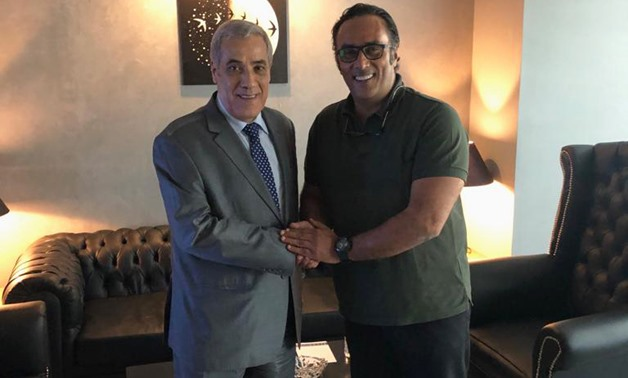 (L to R): Algerian Ambassador in Cairo Nazir Al Arabawy shaking hands with Chairman and Managing Director of Tazkarti Marketing services company, Montasser Al Nabarawy