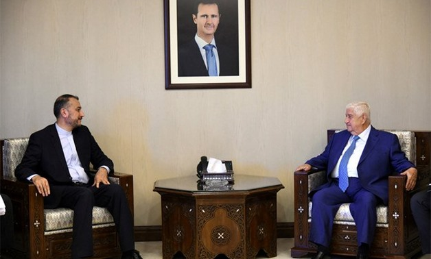 Hossein Amir Abdollahian, a special aide to the speaker of Iranian Parliament on international affairs, meets with Syria's Foreign Minister Walid Muallem in Damascus, Syria, on July 15, 2019. Abdollahian also met with Lebanese officials on July 17. (Reute