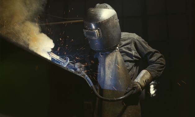 Welder making boilers for a ship, Combustion Engineering Company. Chattanooga, Tennessee, June 1942. CC via Wikimedia Commons/Alfred T. Palmer