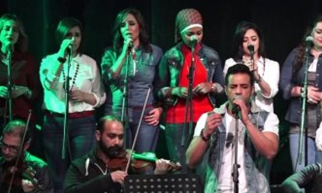 FILE - Ayamna el Helwa band