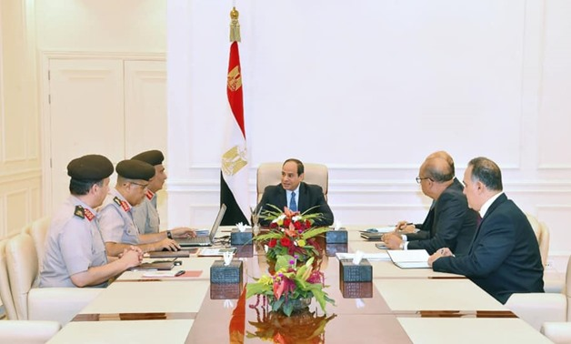 Sisi meets with chairman of the Armed Forces Engineering Authority Ihab el Far and a number of engineering directors - Press photo